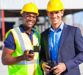 engineer and construction worker smiling