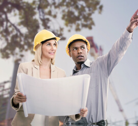 engineer and construction worker looking at something